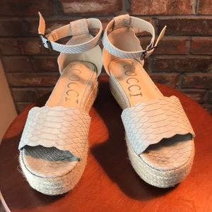 Gray espadrilles that have snake skin pattern